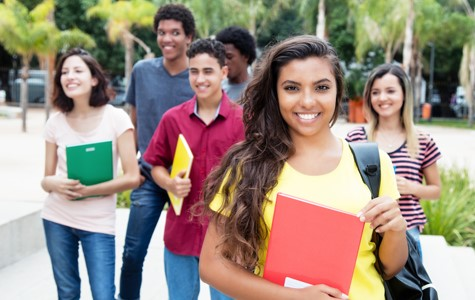diverse students walking on campus