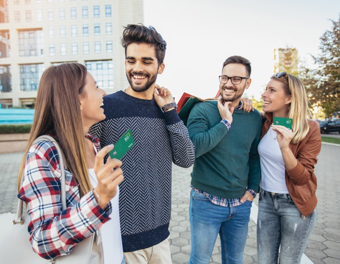 Young adults holding debit cards