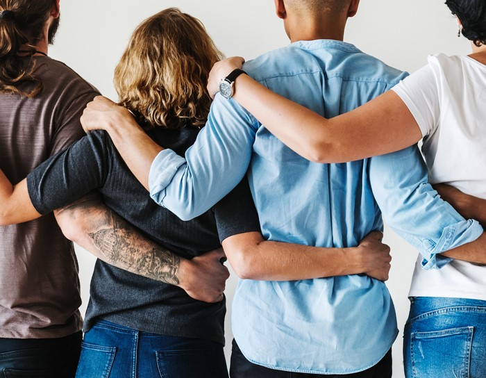 Diverse people hugging