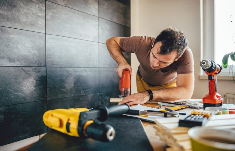 Man using tools at home