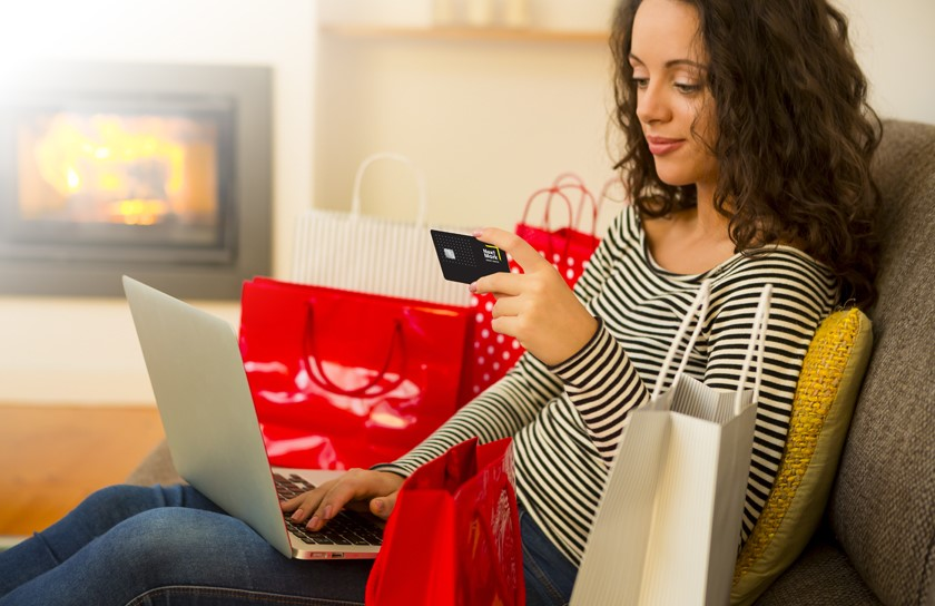 Woman online shopping holding credit card