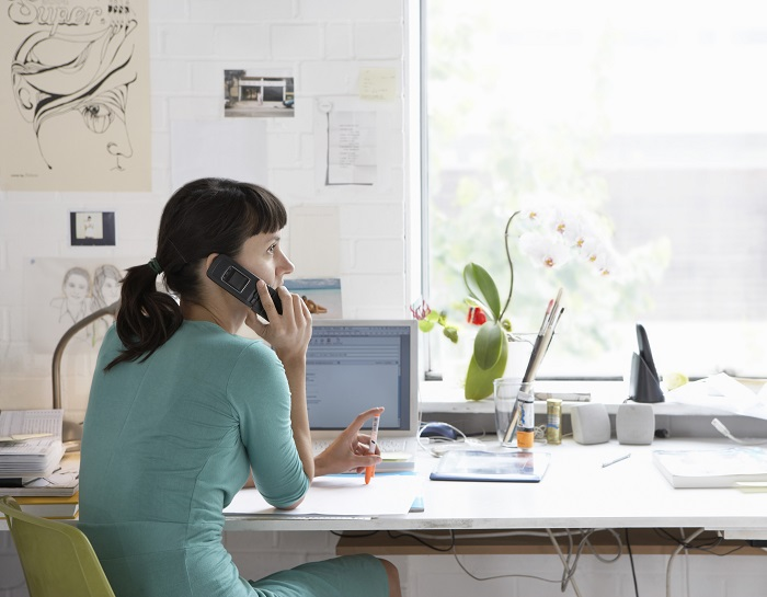 woman on phone working