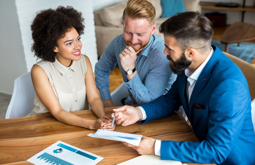 man and woman with a financial advisor